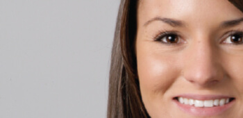 Face of woman with white to olive skin color